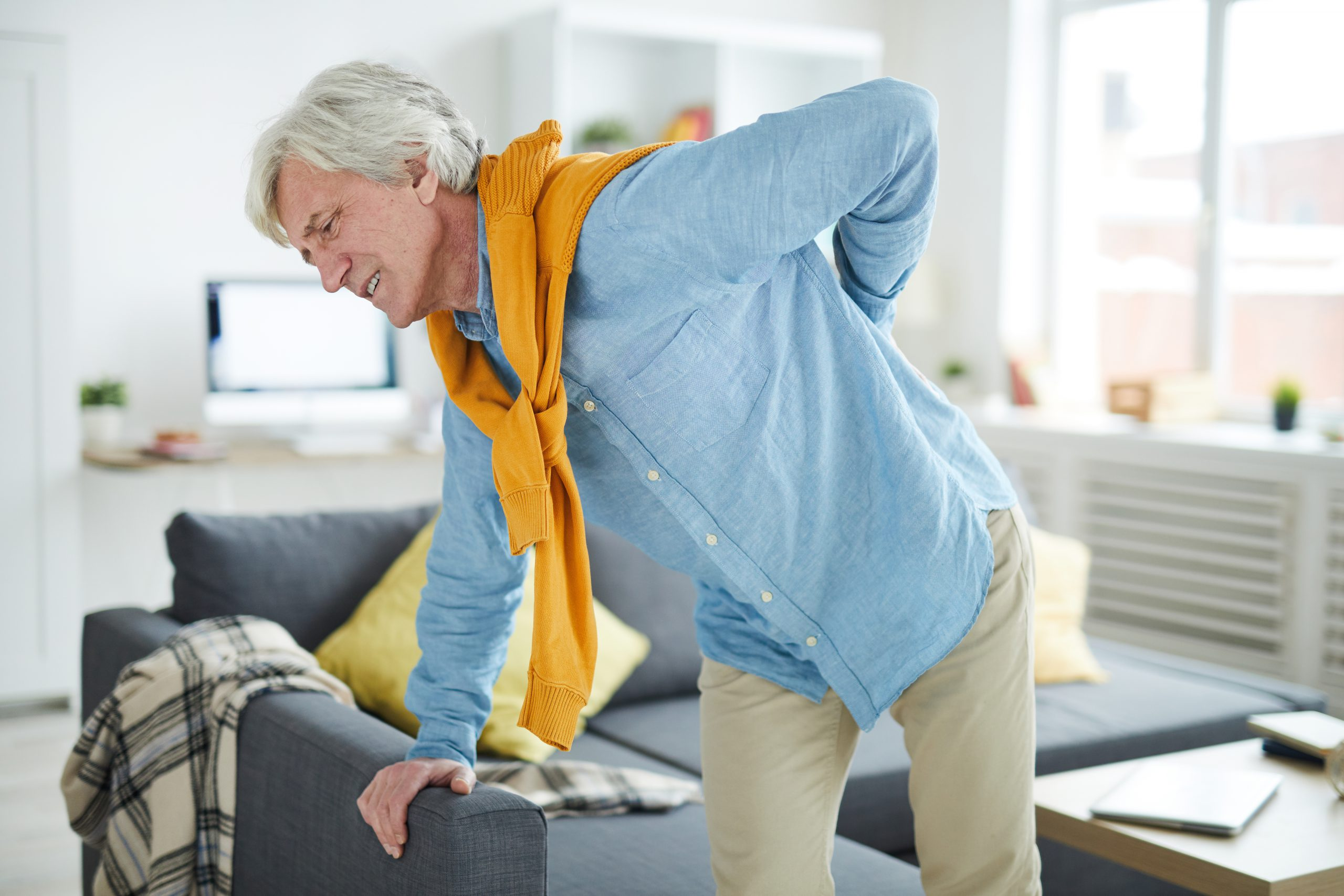 Image of an older person with back pain